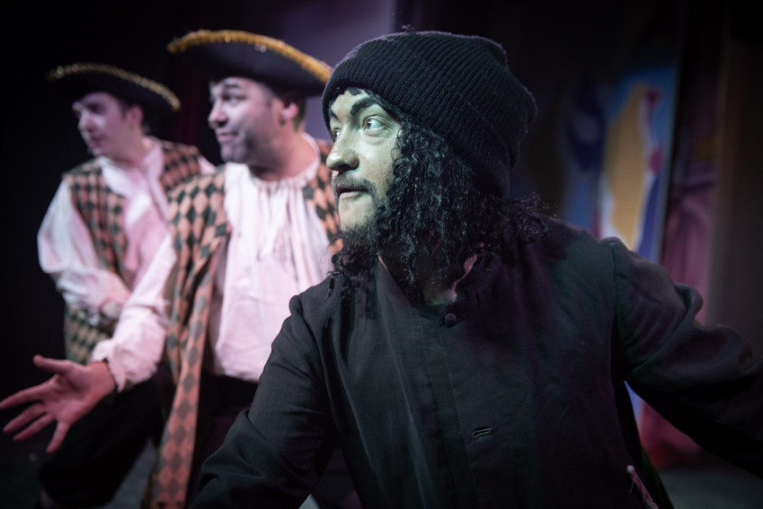 "Close up photograph from Bolton theatre stage production ""Jack and the Beanstalk"" featuring Rancid the Ratman  with the bailiffs: Scarper and Snatched in the background."