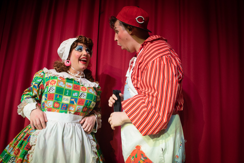"Photograph Bolton from theatre production of ""Jack and the Beanstalk"" featuring Dame Dotty Dimple in conversation with her son Simple Simon."