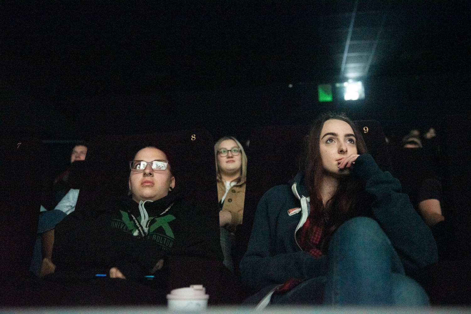 Close up of viewers watching a screening of a short film during the festival