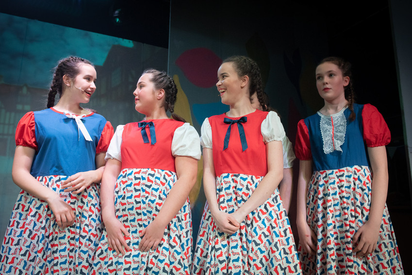 "Group of four choir girls on stage of the Bolton theatre production of ""Jack and the Beanstalk""."