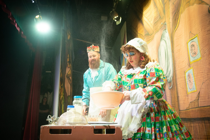 "Image from Bolton theatre production of ""Jack and the Beanstalk"" featuring King Crumble and Dame Dotty Dimple cooking."