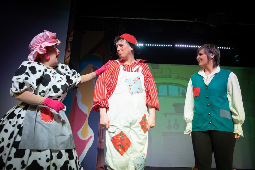 "Close up photograph from Bolton theatre production of ""Jack and the Beanstalk"" featuring Dame Dotty Dimple comforting her son Simple Simon with Jack looking over."