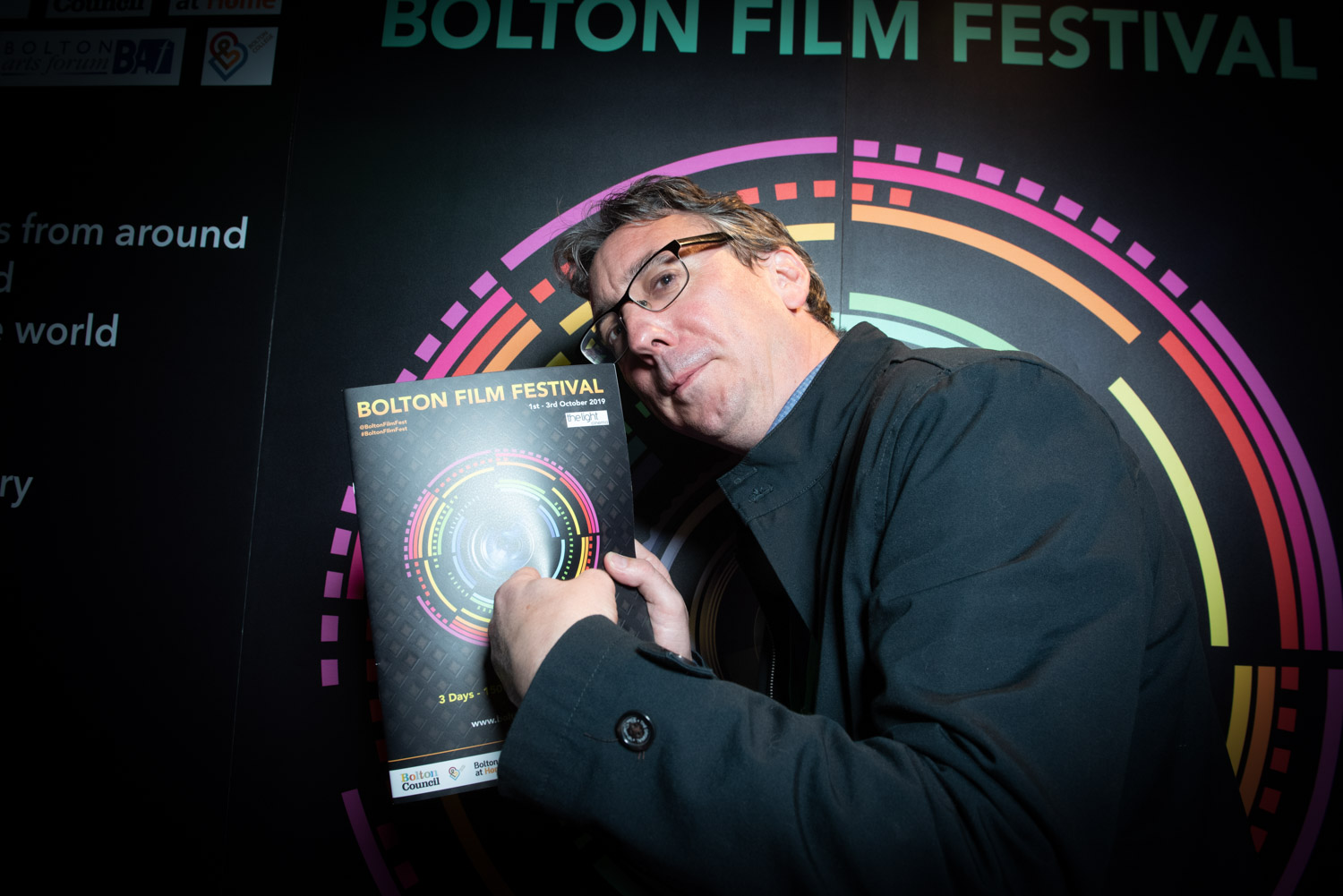 Keith Farrell film Director showing off copy of the festival programme