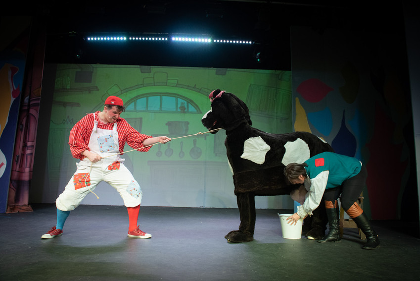 "Photo from Bolton theatre production of ""Jack and the Beanstalk"" featuring Simple Simon and Jack trying to frantically milk their cow Buttermilk."