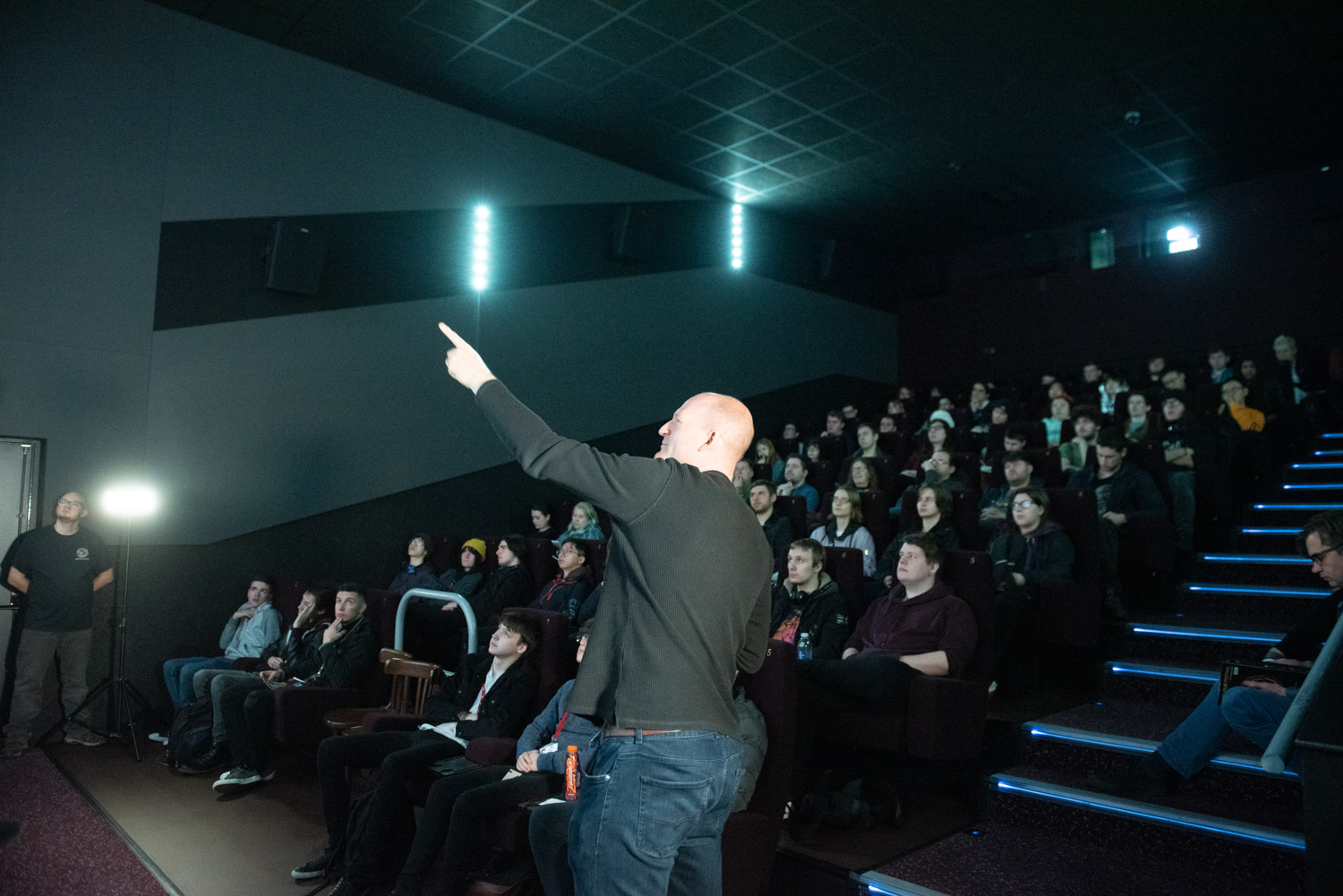 Jon Turner of Kilogramme Studio addressing the audience in cinema, pointing to something on the screen