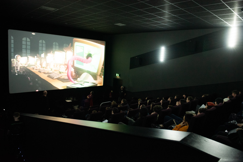 Audience members enjoying an animation short film