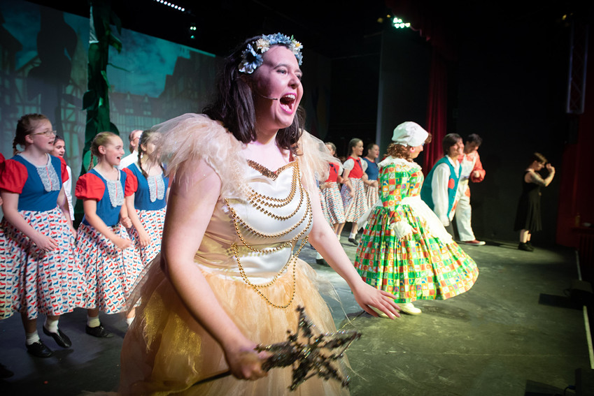 "Image from Bolton theatre production of ""Jack and the Beanstalk"" featuring various characters dancing on the stage with Fairy Sugardust in the centre."