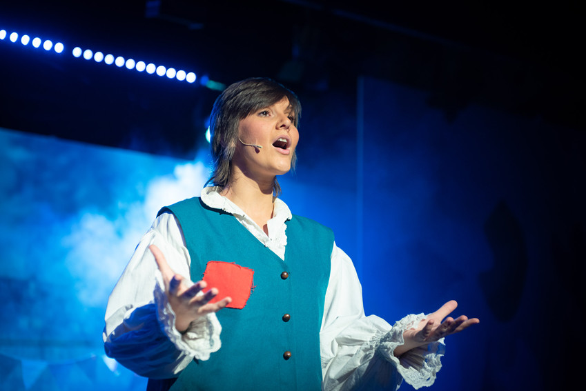 "Close up photograph from Bolton theatre production of ""Jack and the Beanstalk"" featuring main character- Jack singing."