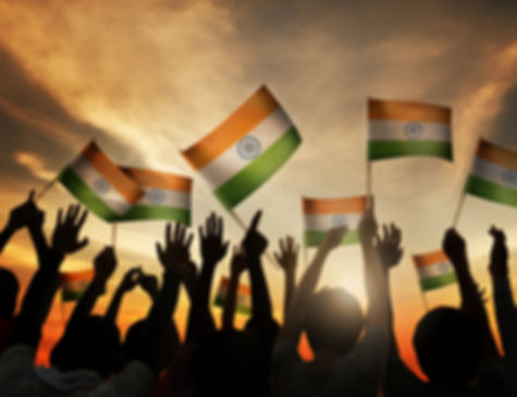 Group of People Waving Indian Flags in B