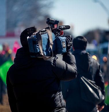 man carrying professional camera_edited.