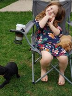 puppy sleeping with child on chair