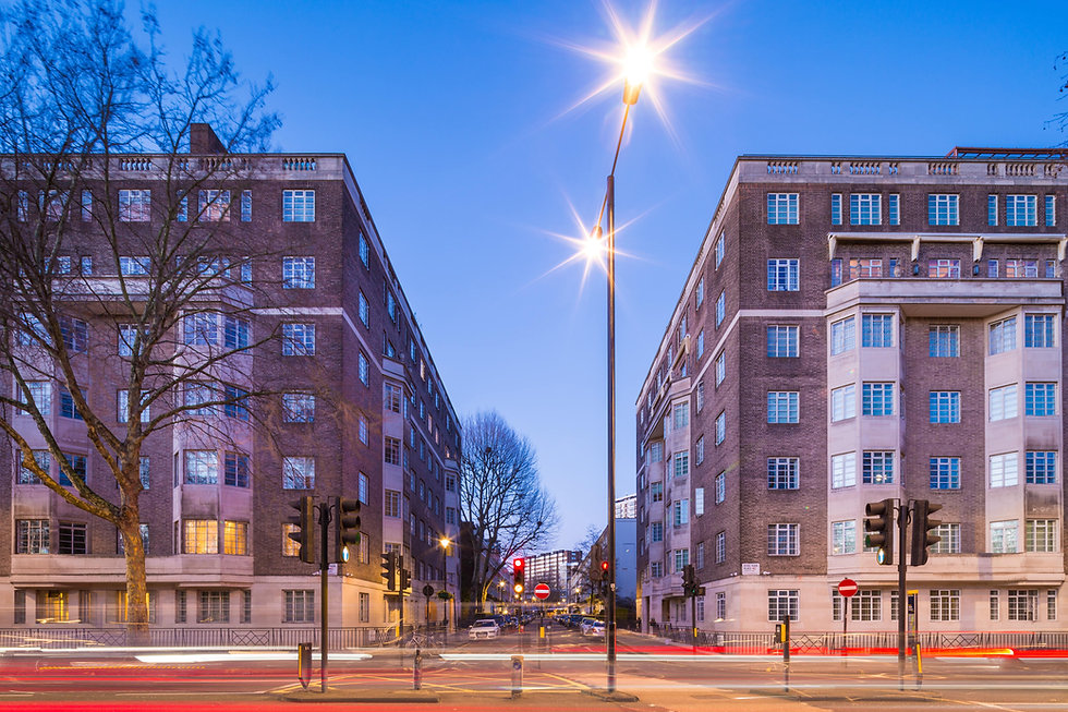 Photo of art deco buildings in central London at night