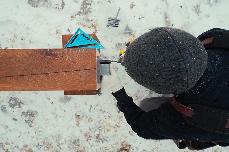 Home builder preparing beams for custom home in Quinte