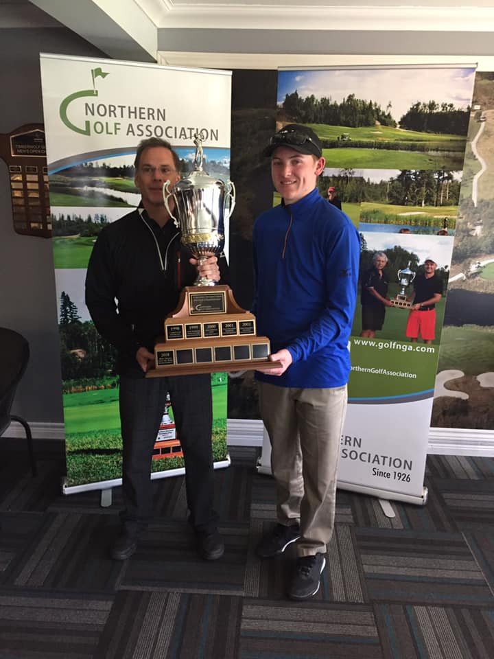 Jacob Lacko (Timberwolf) accepting the Northern Ontario Amateur Championship trophy.
