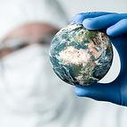 2 - Doctor Holding Globe - Square.jpg