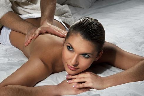 Beautiful woman enjoying a massage on be