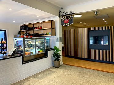 Ottrey Homes face lift existing entrance area to changed to a cafe. Timber battens were added to existing partition wall to provide a modern look to the aged care facility