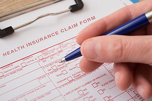 Health insurance claim form with pen _ed
