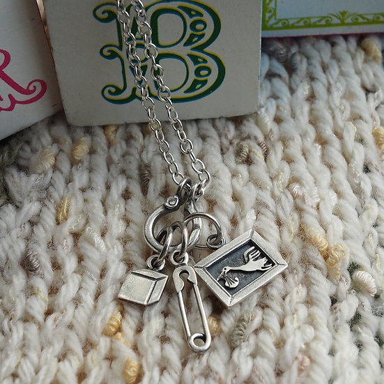 WELCOME TO THE WORLD CHARM NECKLACE
