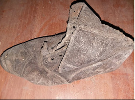 Home renovator finds a shoe hidden in wall of century old Hannibal house