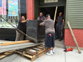 Old safe's removal from historic building requires combination of ingenuity, brawn