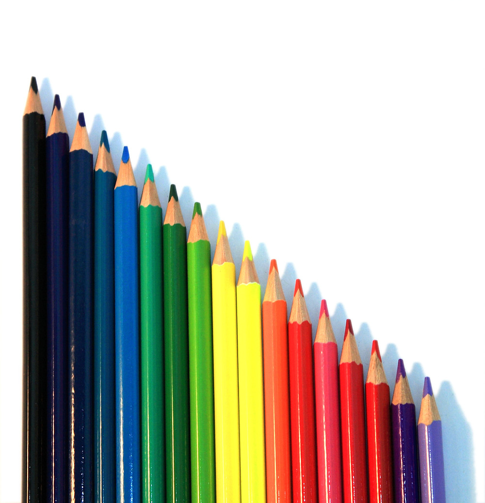 Pencils lined up in a rainbow of colours