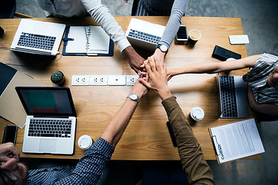 team-business-people-stacking-hands.jpg
