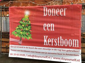 Doneer een kerstboom (of een oliebol als de boom wat heftig is)