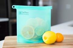 lemons, limes, oranges, cut citrus fruits Saffron Goods Fill and Slide Reusable Silicone Storage Bags