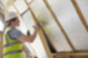 Builder Installing Insulating Board Into