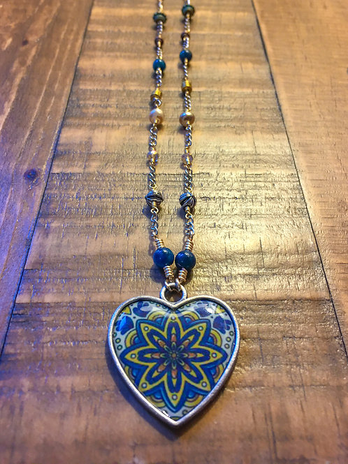 have a heart necklace (with bleu brazilian apatite)