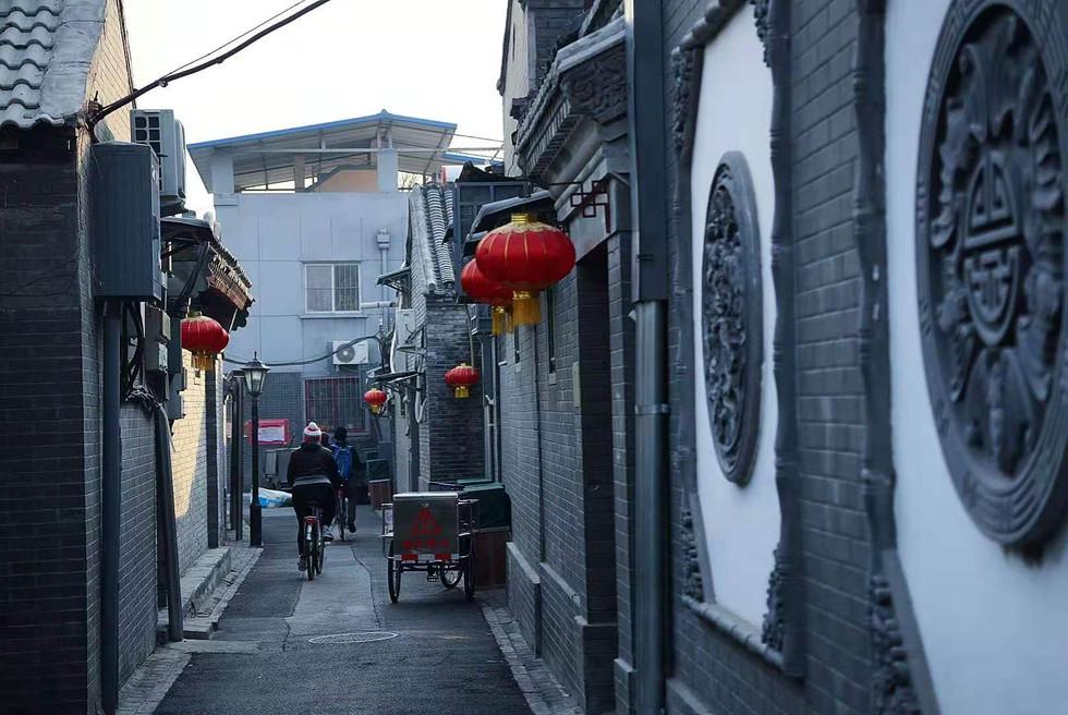 Riding through the Hutongs of Beijing.