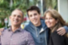 teenage boy and parents smiling.jpg
