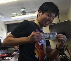 student with 20 dollar bill.JPEG