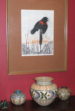 Among Cathra-Anne's pieces in Sandy's Texas home are Scottish Thistle and Palmetto vases