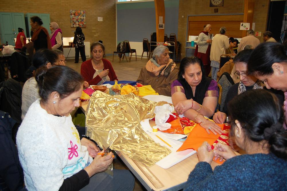 Members of Ekta Unity creating fabric books of memories