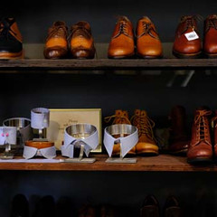 Shelf of shoes, shirt collar and cuff samples