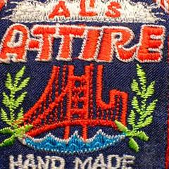Al's Attire embroidered label