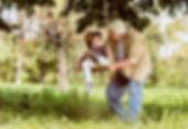Grandad swinging granchild on swing, The Jackson Clinic, ENT SpecialistClinic ENT family health