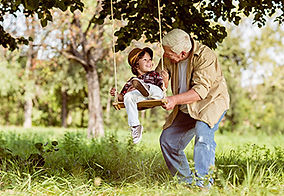 Grandad swinging granchild on swing, The Jackson Clinic, ENT SpecialistClinic ENT family health