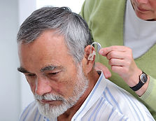 ThJackson Clinic ENT hearing aid being fitted