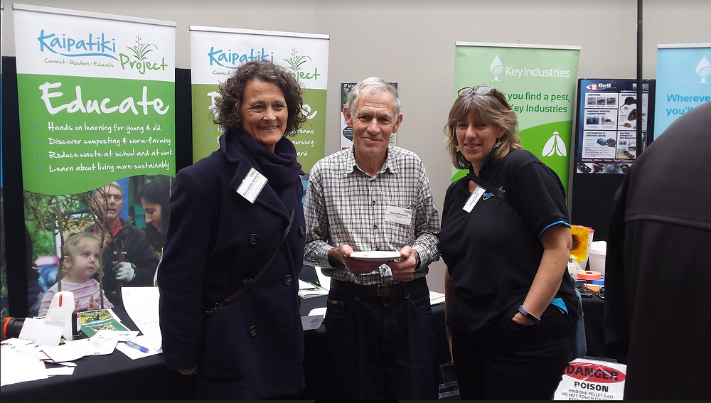 Bernadette, David and Janet in front of the PFK / Kaipatiki Project stall