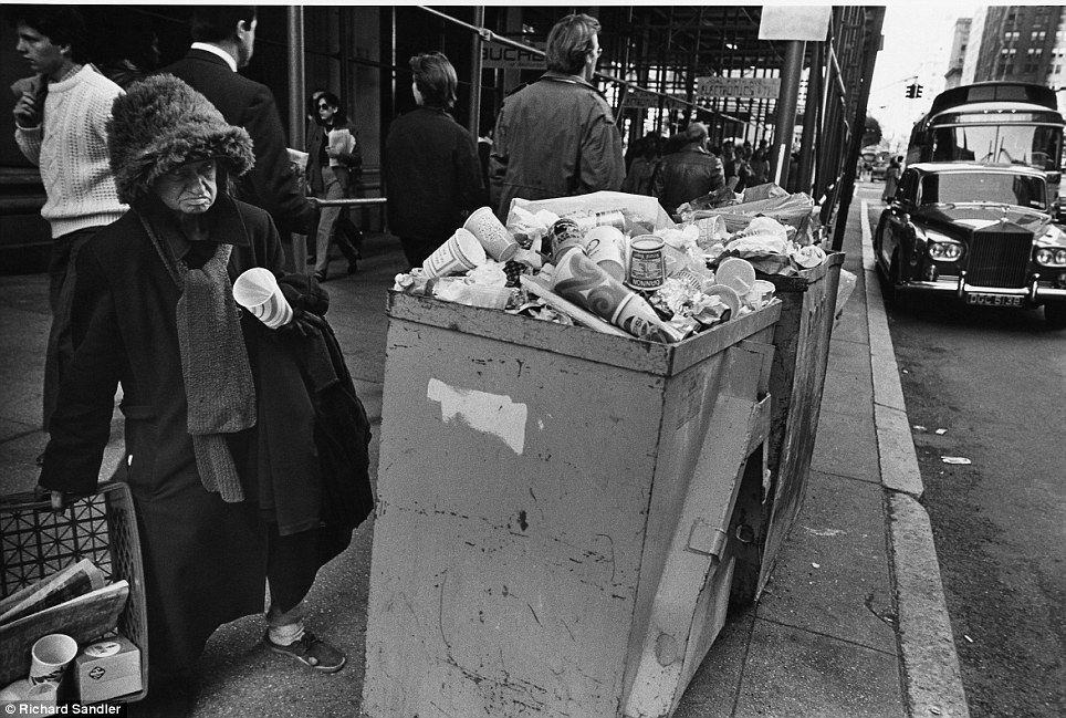 Life on the streets- A homeless woman stands bear overflowing trash on Fifth Ave in 1980