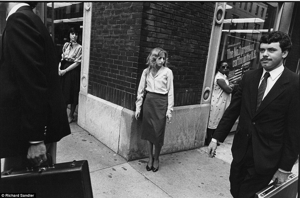 Cigarette break- A woman puffs a cigarette in the days before 'No smoking within 25 feet' signs on M