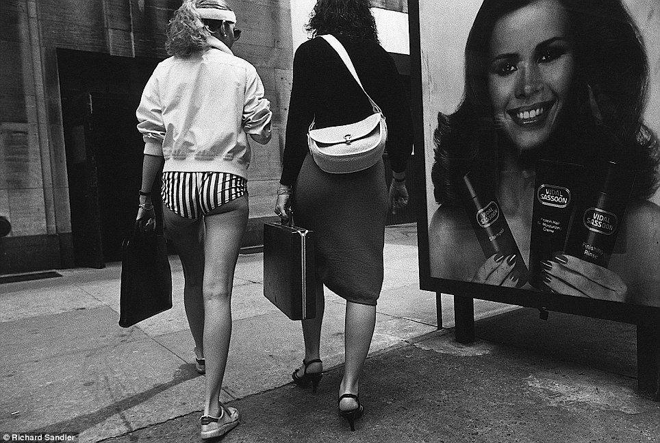 Short shorts- Two women walk together on 34th Street in 1980, one clad in extremely brief pants and