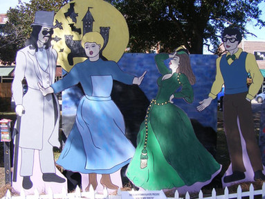 The 2014 display designed for The Flowertown Players season of shows. Creating these life size cut outs was challenging and fun.