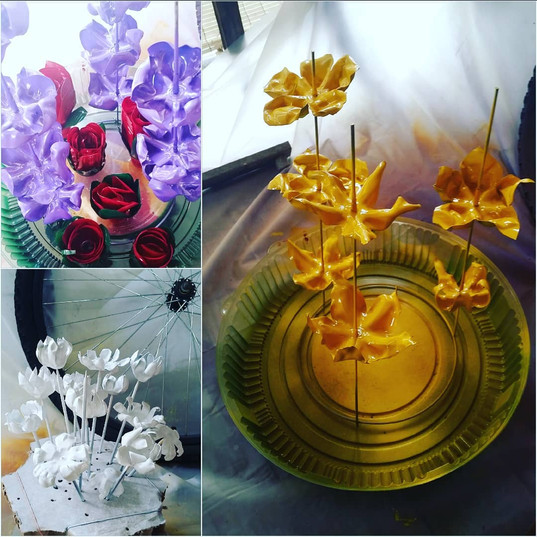 Soda bottle flowers. Painting stage.
