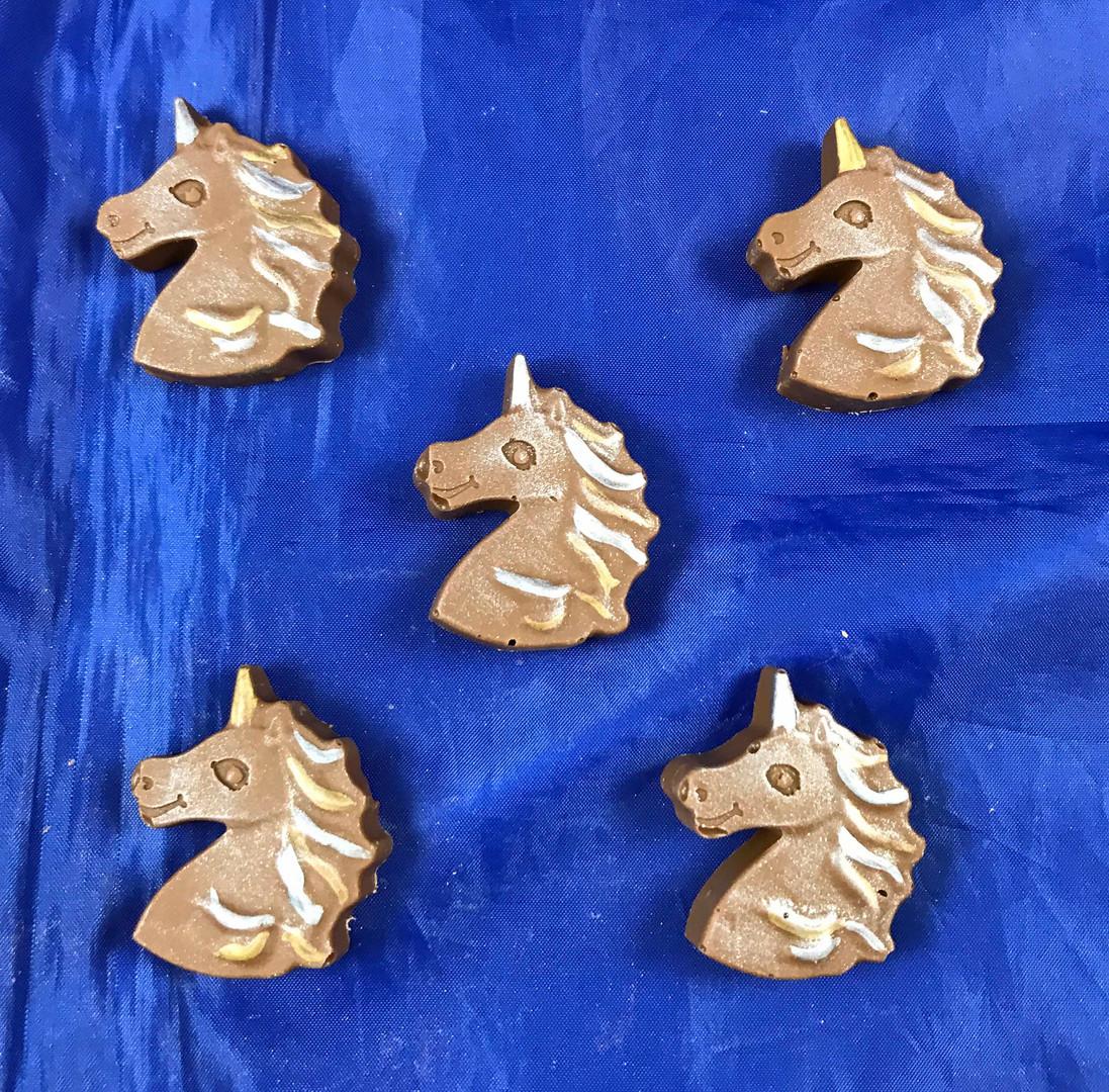 Milk chocolate unicorn heads.jpg