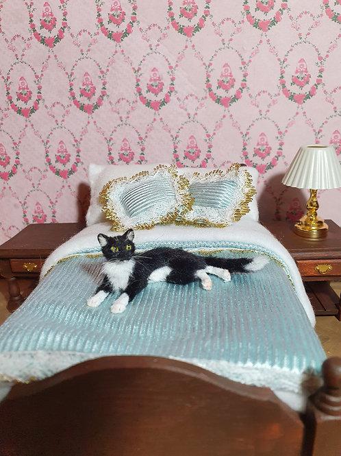 One of a kind miniature Tuxedo cat