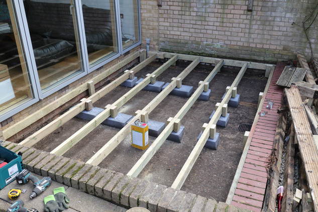 All new joists and no bricks, air flow all around with galvanised spacers and legs.